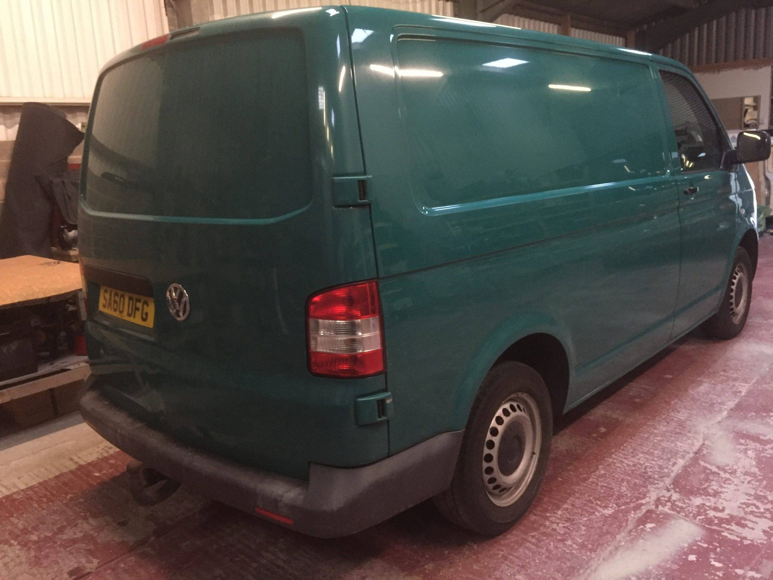 green camper van getting paint job