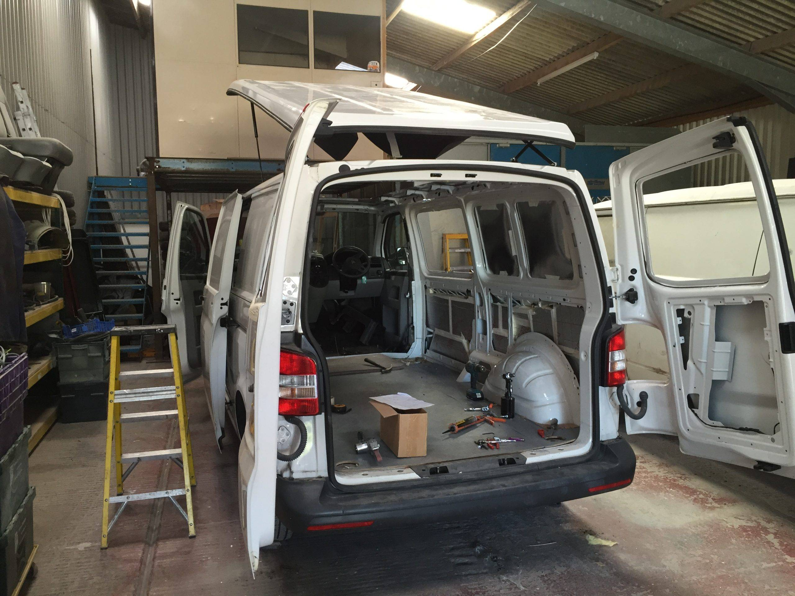white camper van preparing for conversion