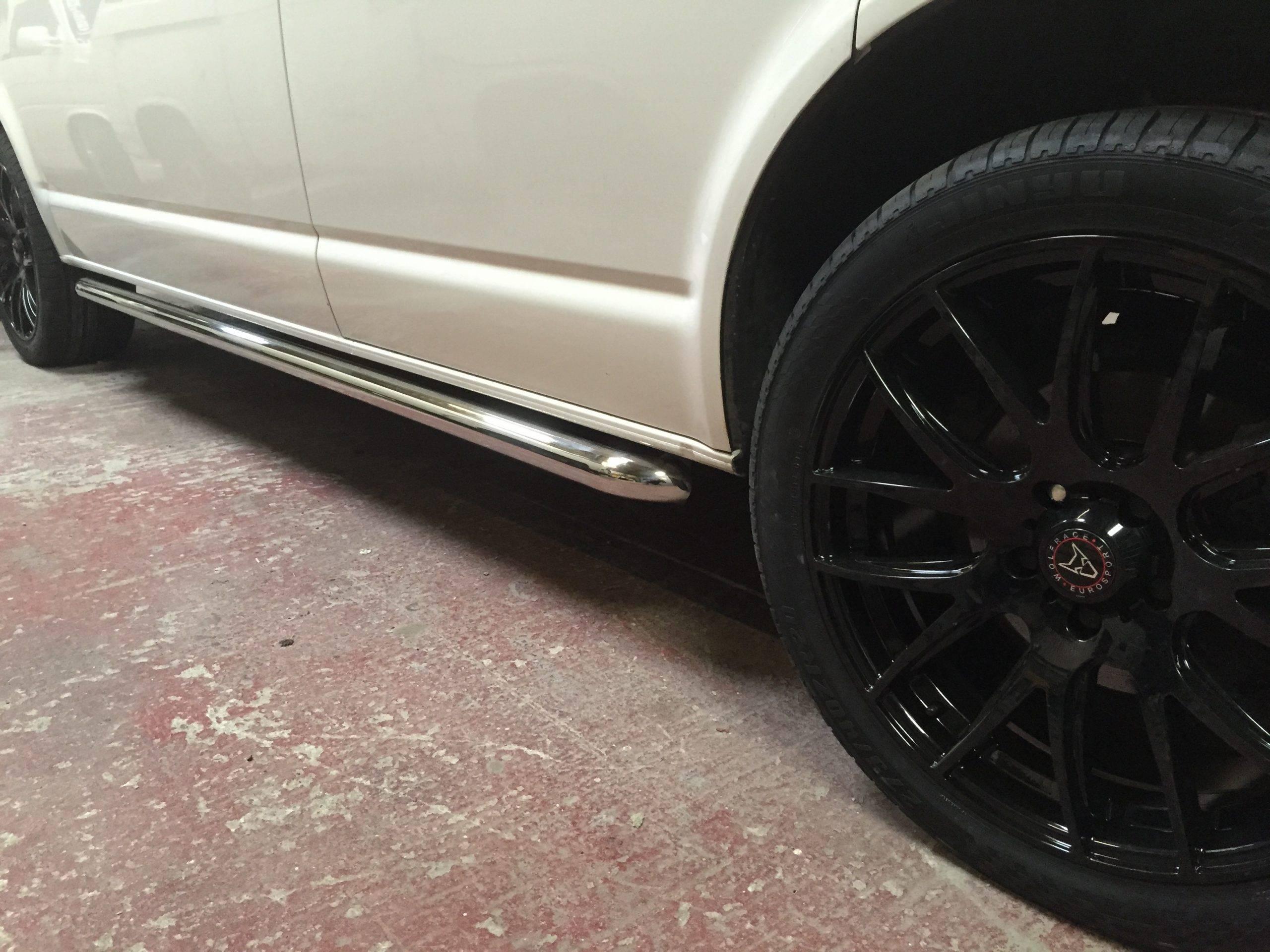 black alloys on white camper van