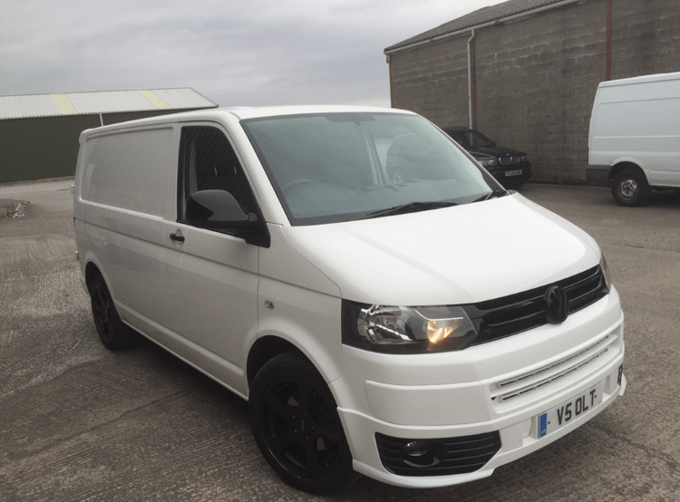 white vw van with black detailing