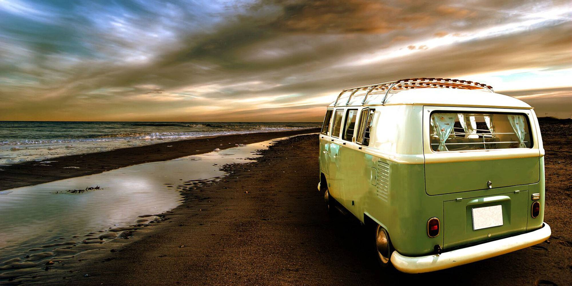 green vw campervan on beach